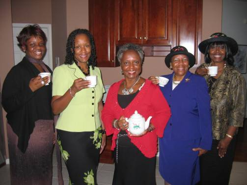 Tea guests pose for picture with author.